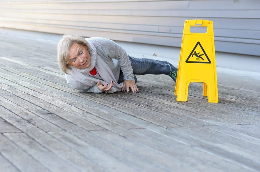 slip and fall elderly woman in a public building